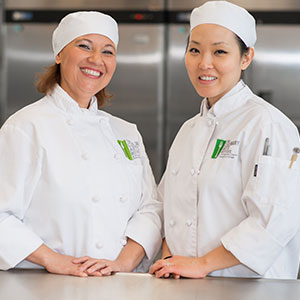 2 woman in chef clothes