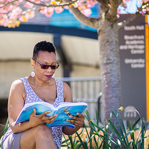 Woman studying on bench at West Campus