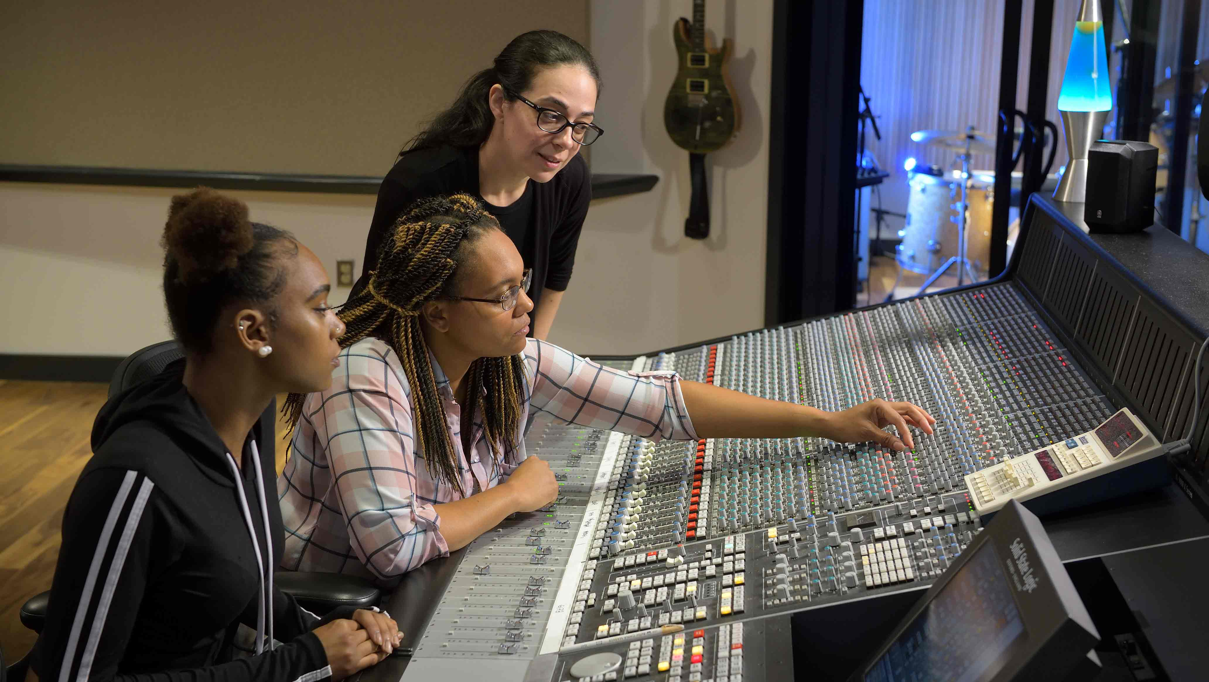 SRT Instructor Jen Mitlas working with students Shea Walker and her daughter Sasha Walker in Montco's new mixing suite. Photo by David DeBalko