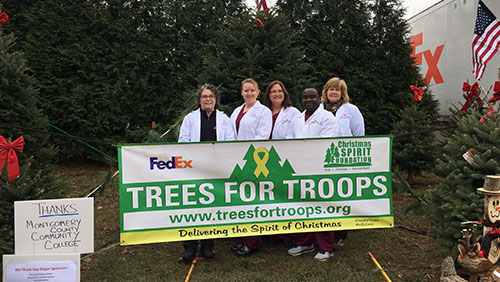 MCCC's nursing students donated 25 Christmas trees to military families this year to brighten their holidays.